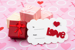 Happy Valentines Day. A stack of pretty presents with love postcard on a pink love background, happy valentines day Stock Photos