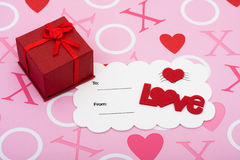 Happy Valentines Day. A pretty present with love postcard on a pink love background, happy valentines day Stock Image
