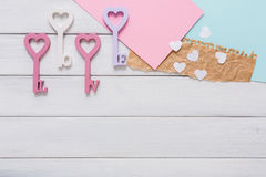 Happy Valentines Day background, key hearts. Copy space on wood Stock Photography