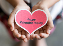 Happy valentines day card on hands Royalty Free Stock Images
