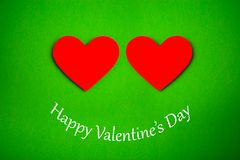 Happy Valentines Day card with red paper heart. On green background Stock Photos