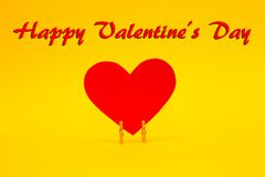 Happy Valentines Day card with red paper heart. On yellow background Stock Photo