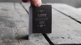 Happy valentines day card. On a rustic wooden background stock video footage