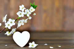 Happy Valentines Day card with spring flowers and decorative heart Royalty Free Stock Images