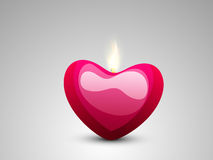 Happy Valentines Day celebration with heart shaped candle. Stock Image