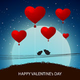 Happy Valentines Day celebration with red balloon. Royalty Free Stock Photo