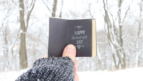 Happy Valentines day concept - vintage book with inscription. Happy Valentines day . Hand holding a book with the inscription stock video
