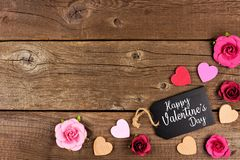 Happy Valentines Day Corner Border With Gift Tag, Hearts And Roses Against Rustic Wood Stock Photography