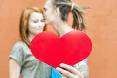 Happy Valentines Day couple holding red heart symbol Stock Photography