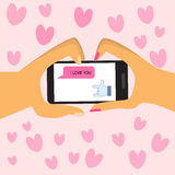 Happy Valentines day .Couples hold smart phone with love hand si Royalty Free Stock Photos
