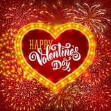 Happy Valentines Day. Festive firework bursting in various shapes and red colors sparkling on red background. Calligraphy inscription Valentines Day in luminous Stock Images