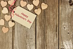 Happy Valentines Day gift tag with hearts on rustic wood Royalty Free Stock Photos