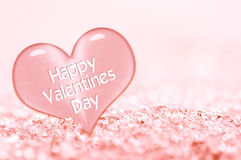 Happy Valentines day greeting card, close up on a pink ice heart Stock Photography