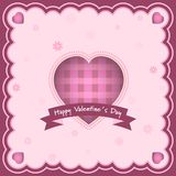 Happy Valentines Day greeting card with heart and inscription in the middle. Flowers in the background. Stock Photography