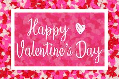 Happy Valentines Day greeting card with white text over a candy heart background royalty free stock image