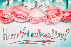 Happy Valentines Day greeting, handwritten, with pink roses and bokeh Stock Photography