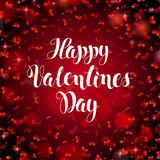 Happy valentines day handwritten text on blurred background. Royalty Free Stock Photo