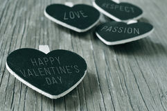 Happy valentines day in a heart-shaped chalkboard, in black and Stock Image