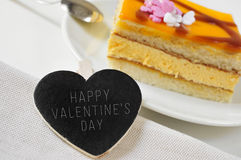 Happy valentines day in a heart-shaped chalkboard and a piece of Stock Images