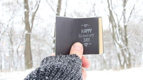 Happy Valentines day idea - retro book with inscription. Happy Valentines day . Hand holding a book with the inscription stock video footage
