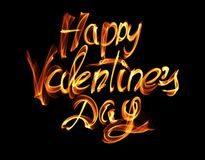 Happy Valentines day isolated words lettering written with fire flame or smoke on black background.  Stock Image
