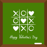 Happy Valentines Day. Love card. Tic tac toe game with cross and three heart sign mark XOXO Chalk line on school board. Wooden fra Royalty Free Stock Image