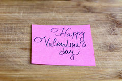 HAPPY valentines day pink greeting card on a wooden background Stock Photography