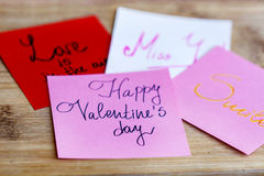 HAPPY valentines day pink greeting cards on a wooden background Stock Photo