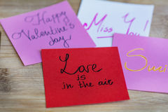 HAPPY valentines day pink greeting cards on a wooden background Royalty Free Stock Photography