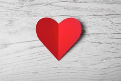 Happy Valentines day, Red Heart from paper on wood tabel. Good Holiday. Card Stock Image