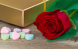 Happy Valentines day with red rose and gifts on rustic wood Stock Photography
