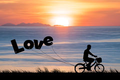 Happy Valentines Day, silhouette man bike at twilight sunset sky Royalty Free Stock Photos