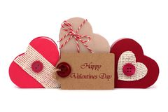 Happy Valentines Day tag with heart-shaped gift boxes over white Royalty Free Stock Images