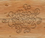 Happy Valentines day vintage lettering written by smoke over wooden background Royalty Free Stock Images
