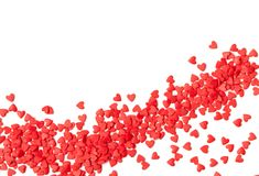 A scattering of sweet red hearts on a white background stock photo