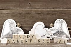 Happy Valentines Day wooden blocks with rustic decor over wood Royalty Free Stock Photos