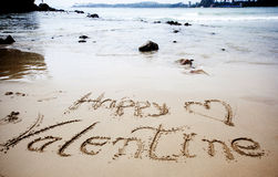 Happy Valentines day! written in sand Royalty Free Stock Photo