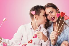 Happy Valentines or mother day. Happy Valentines Day or Mother day. Young boy spend time with his mum and celebrate with gingerbread heart cookies on a stick on stock image