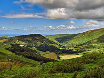 Happy Valley or Cwm Maethlon. Happy Valley is the Victorian name for Cwm Maethlon the mountain road is the scenic route of the old coaching road between Royalty Free Stock Photo