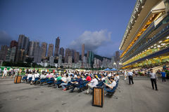 Happy Valley Racecourse in Hong Kong. A bustling scene from the Happy Wednesday Finale. Happy Valley Racecourse is one of the two racecourses for horse racing Stock Photography