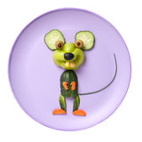 Happy vegetable mouse on pink plate Royalty Free Stock Photo