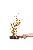 Happy vegetables. Colorful vegetables flying above the cooking pot stock images