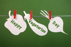 Happy Vegetarian Day message greeting written across vegetable cards hanging from pegs on a line Royalty Free Stock Photo
