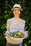 Happy vegetarian woman with salad Stock Photo