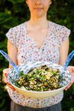 Happy vegetarian woman with salad royalty free stock photography