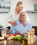 Happy vegetarian woman  smiling with senior and  cooking Stock Photo