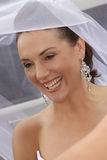Happy Veil. A bride under her veil before entering chapel Royalty Free Stock Photos