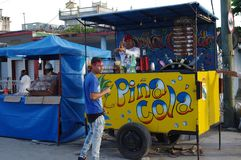 Happy vendor of flavored cold drinks in Latin America. Happy vendor at a stand selling flavored cold drinks in Latin America Royalty Free Stock Photography