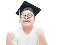 Happy and  very glad asian school kid graduate with graduation c Stock Photography