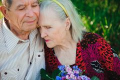 Happy and very old people sitting in the park.  stock photography